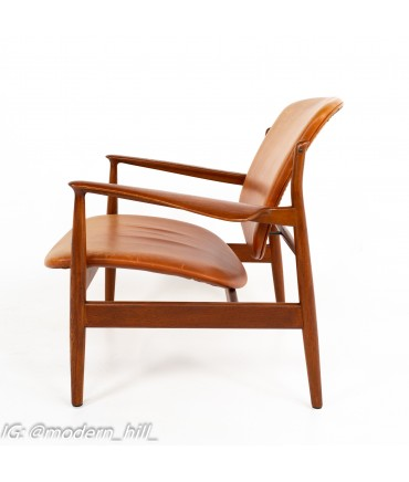 Finn Juhl for France and Son FJ136 Mid Century Teak and Leather Lounge Chair